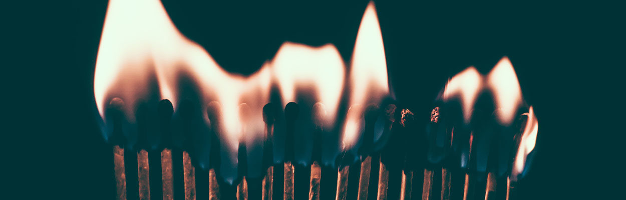 a row of matches on fire