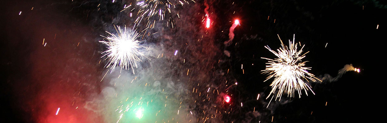 fireworks with hazy red and green smoke